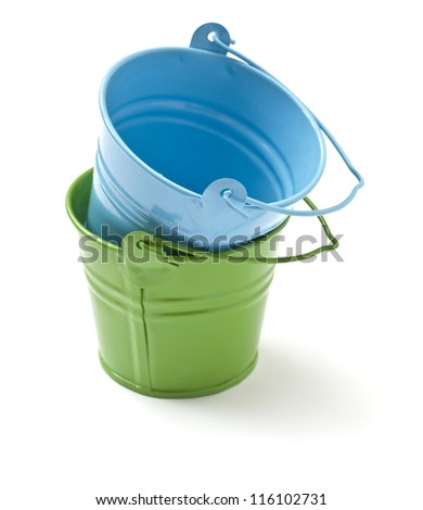 Small decorative green and blue buckets  isolated on white background #116102731