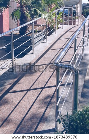 Small Decorative Pedestrian Bridge With Stainless Steel Railing And Tailed Marble Floor In Tropical Garden Or Park Stok fotoğraf ©