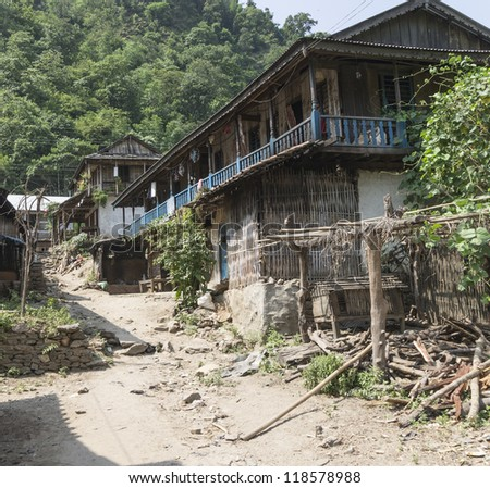 small dirty path with some houses in village in nepal