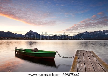 Small Dock and Boat at the lake, sunrise in autumn