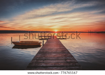 Small Dock and Boat at the lake, sunset shot