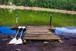 Small dock with boat paddles at Echo Point, Munnar, Kerala, India