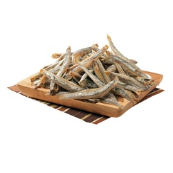 Small Dried fish on a square wooden plate and a striped napkin