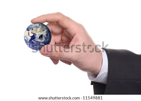 small earth in a hand on white background