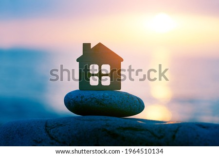 Small eco wooden house on sea beach at sunset, family travel and summer vacation, spirituality, solitude concept Stock photo ©