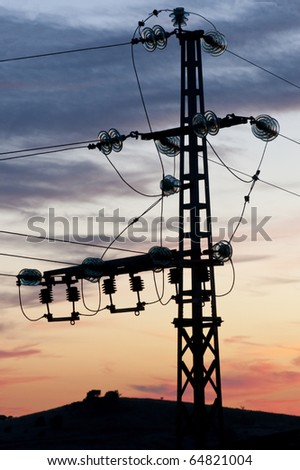 Small electricity pylon with power lines connecting in for Glass power line insulators