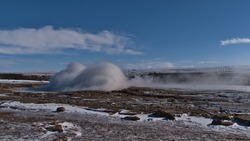 Small eruption of famous geyser Strokkur (Icelandic