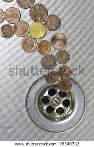 small Euro coins are cast-off and go to drain