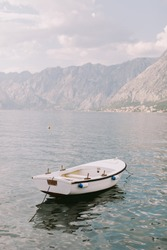 small fisherman boat in bay with mountains view. Beaufitul view with boat and mountains. Kotor, Montenegro.