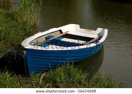 Small fishing boat in a moored pond along the danube delta for Small fishing boats for ponds