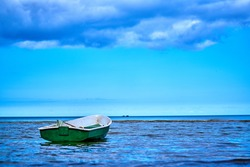 Small fishing boat with fishing net and equipment