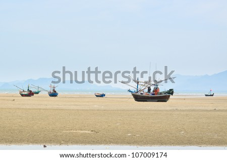 Small fishing boats, Many were stranded beach.