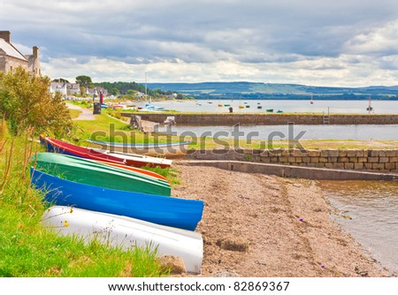 Small fishing boats moored on the edge of the water at Findhorn, Scotland - stock photo