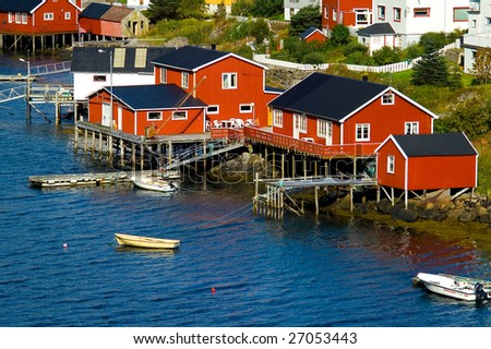 Small fishing village at a base of a high mountain, Lofoten Islands, Norway