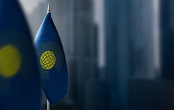 Small flags of Commonwealth on a blurry background of the city