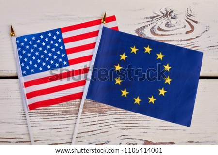 Small flags of USA and Europe. Cocktail flags of America and Europe on vintage wooden surface. #1105414001