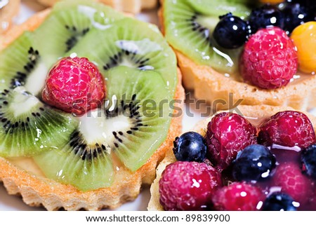 small flan cakes, softegg pastry with berries and fruits