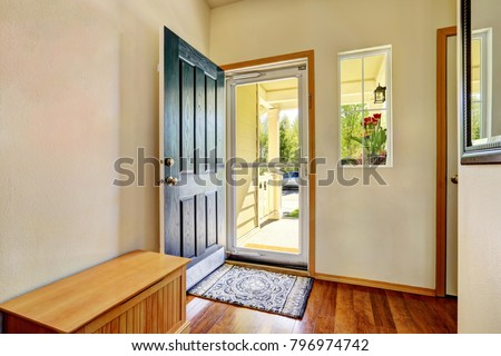 Small foyer with green open front door, laminate floor and wooden bench. Northwest, USA Сток-фото ©