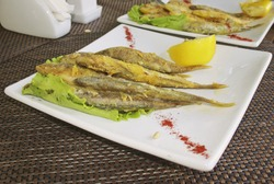 small fried fish in square plates