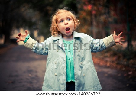 Small funny baby singing outside