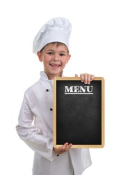 Small funny chef in white uniform holding a menu board, on white background.
