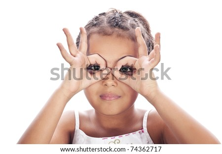 Small funny girl, hands at binoculars
