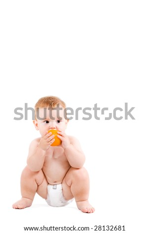small ginger baby seating in nappy and eating orange fruit.Isolated in white.