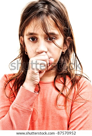 Small girl coughing isolated on a white background