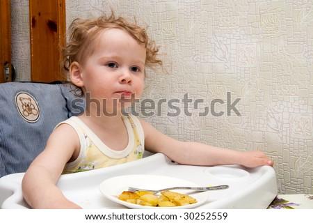 small girl eat fried potato - stock photo