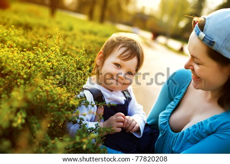 Small girl enjoying life with her mother outdoors