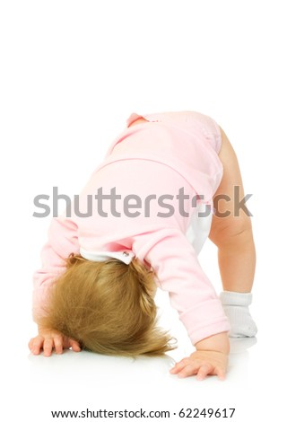 Small girl makes gymnastic exercise isolated on white