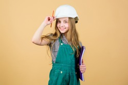 small girl repairing in workshop. Foreman inspector. Repair. Child care development. Safety expert. Future profession. Builder engineer architect. Kid worker in hard hat. This is my place