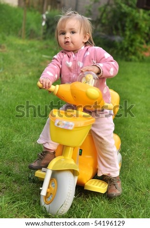 small girl riding bicycle