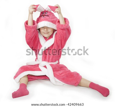 Small girl sitting in the pink Bathrobe of Bunny