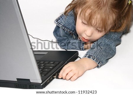 Small Girl Using Laptop and Connecting USB Device.