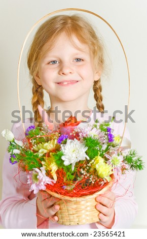 Small girl with a basket of flowers in her hands