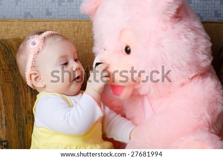 small girl with big toy bear