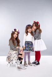 Small girls best girlfriends in a beautiful style fashion clothes collection of dress suit skirt flower crown, happy birthday celebration, funny party kids, dance smile hug daughter sisters children