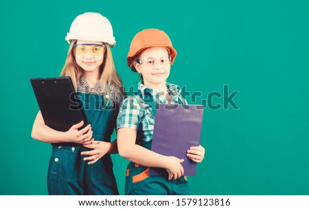 small girls repairing together in workshop. Child care development. Future profession. Builder engineer architect. Kid worker in hard hat. Tools to improve yourself. Repair. Trust to professionals.