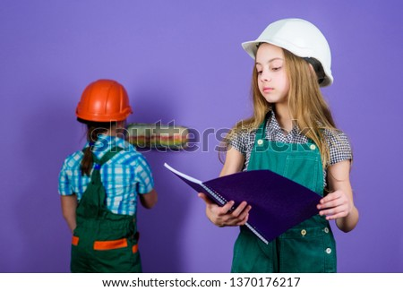 small girls repairing together in workshop. Tools to improve yourself. Repair. Child development. Future profession. Builder engineer architect. Kid worker in hard hat. working tools. building tools. #1370176217