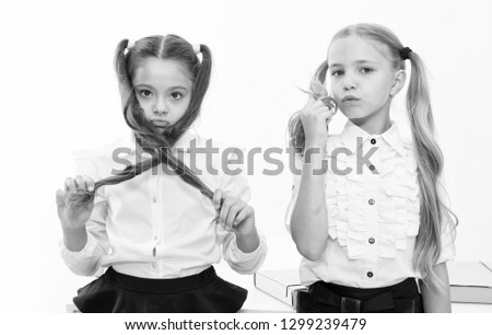 Small girls with tail hairdo. Children need new hairdo in hair salon. small girls back to school.
