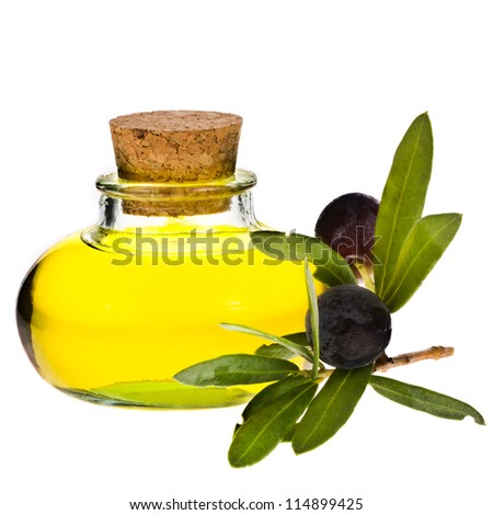 small  glass bottle with olive oil, decorated with a small twig with black olives, fruit, isolated on white background