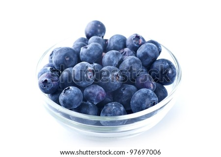 Small Glass Bowl with Fresh Blueberries. Blueberries Isolated on White Horizontal Photo.
