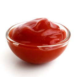 Small glass condiment bowl of red tomato sauce ketchup. Isolated on white in perspective.