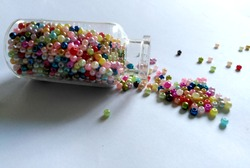 Small Glass Jars filled with Multicolored Balls of Bead