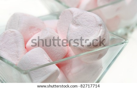 Small glasses  filled with marshmallows  pink