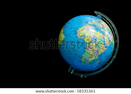 Small globe on black background