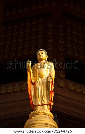 Small golden buddha sculpture