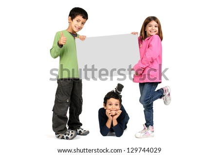 Small group of children with a blank board isolated in white