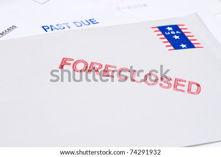 "Small group of envelopes marked ""PAST DUE"" and ""FORECLOSED"".  Suggesting tough economic times US. - stock photo"